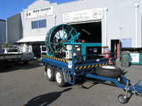 Trailer mounted bore pump reel system